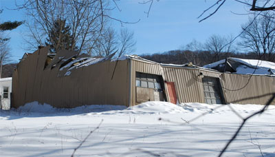 So much snow roofs collapsing in northeast for Snow loads on roofs