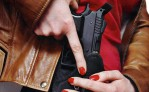 woman-drawing-gun-from-holster