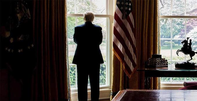 Trump looking out window at Oval Office