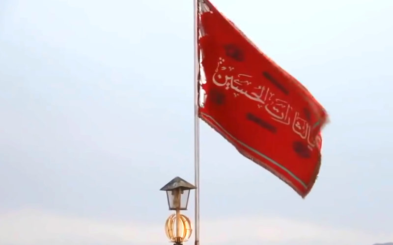 The Red Flag of Hussein raised above the mosque