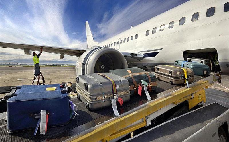 suitcases into plane